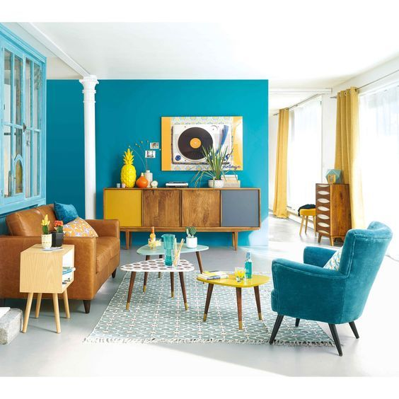 a colorful living room in bright blue, mustard and yellow brings the beauty of mid-century modern esthetics
