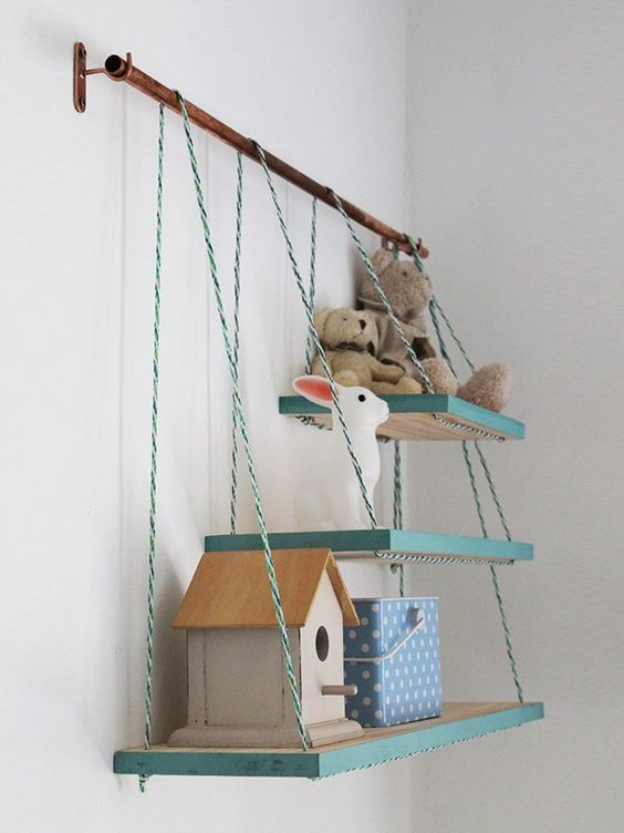 a metal holder with several matching shelves that are different in size will add texture and a fun color touch to the space