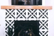 06 super bright black and white geometric tiles and a light-stained wood mantel for a boho chic living room