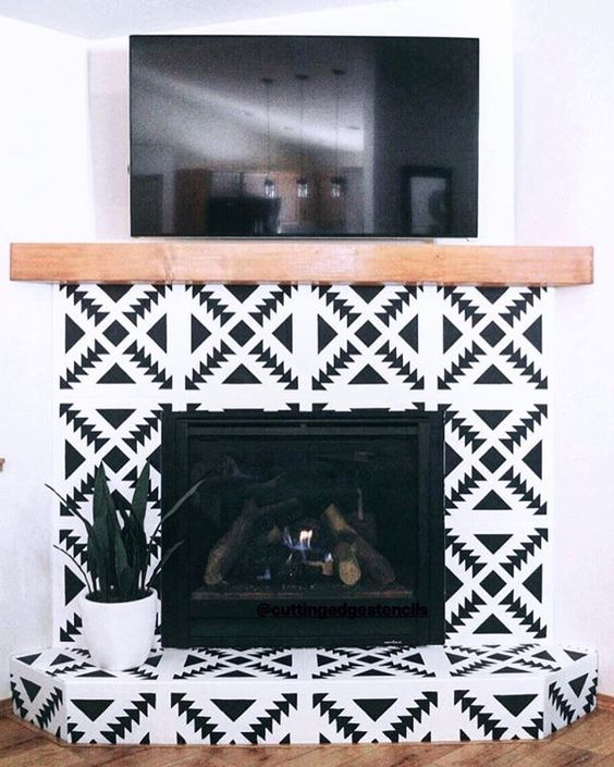 super bright black and white geometric tiles and a light stained wood mantel for a boho chic living room