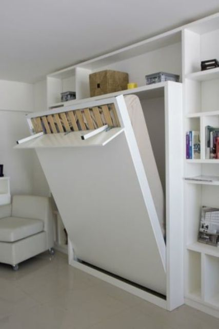 this is how you open a Murphy bed, the legs are hidden under a cover for a sleek look