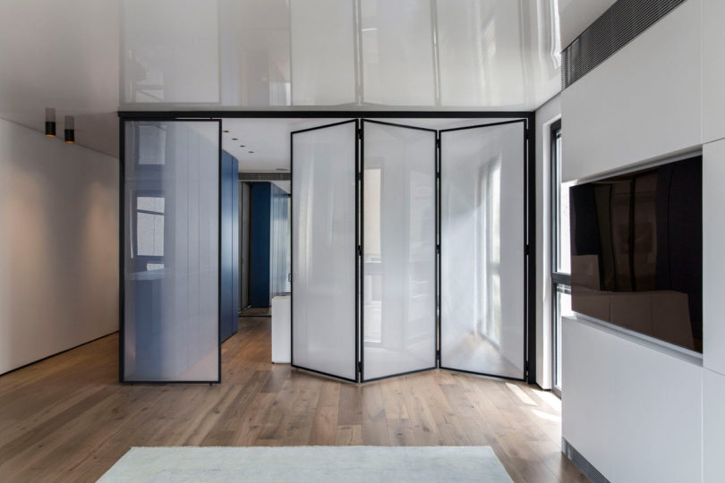 a bedroom that features several space dividers