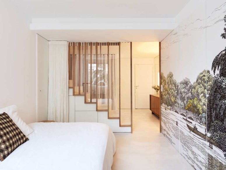 The lower storey features more personal spaces like bedrooms and bathrooms and a glass and wooden screen to separate the staircase