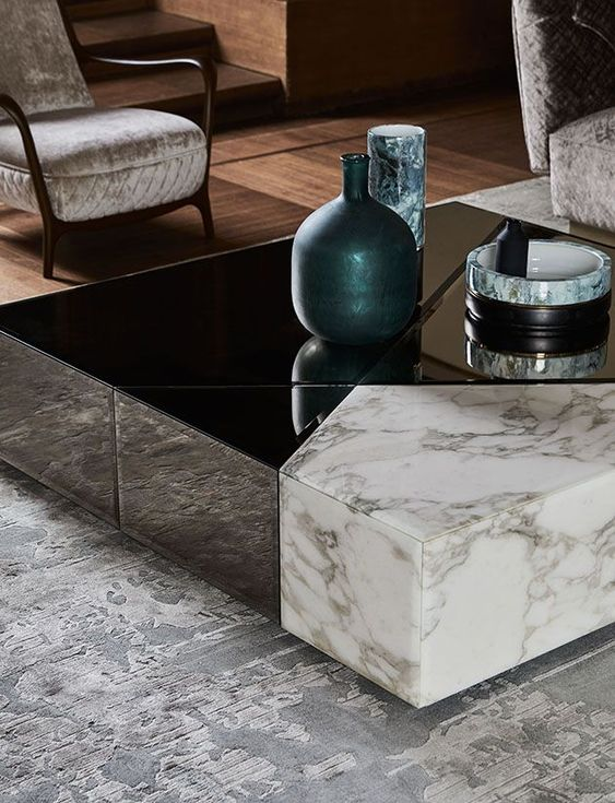 a gorgeous coffee table in black and white marble can be disassembled into several different pieces with geometric shapes