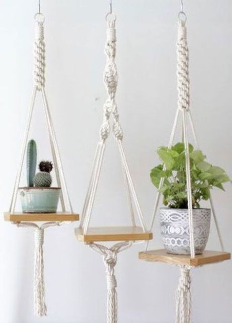 mini hanging shelves with macrame cords and ropes and with tassels are nice to hold planters