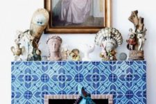07 super bold blue and turquoise patterned tiles echoing blue chairs and a fun statuette create a unique look altogether