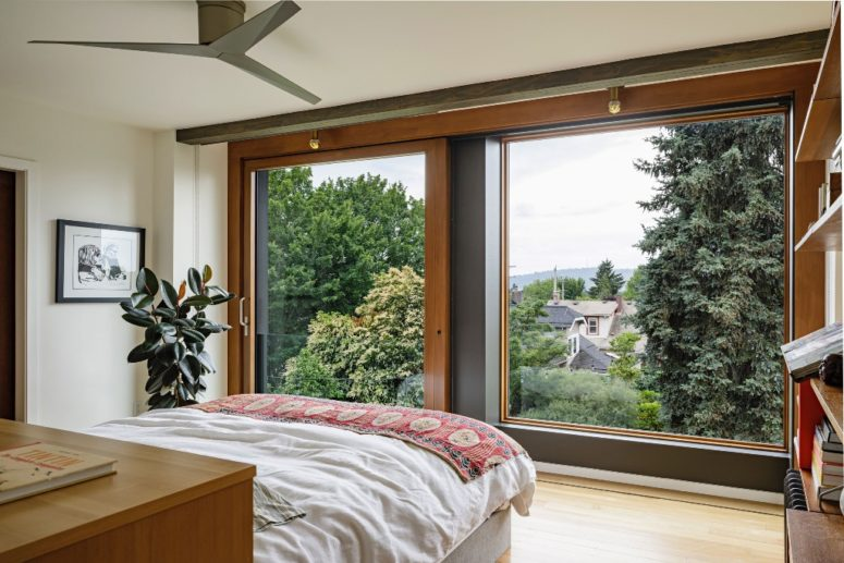 The bedroom is also done with such a window to enjoy the views and there are shades for privacy