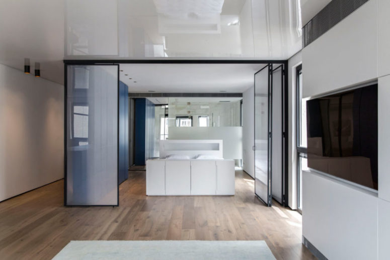 There's also a bathroom integrated into the bedroom and a large sleek blue unit for storage