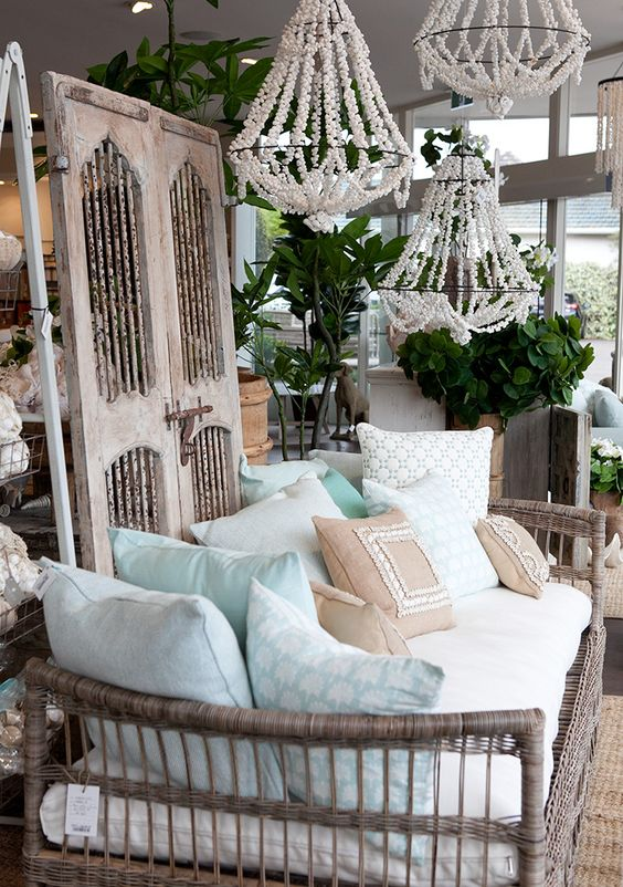 a cane daybed with a ton of pillows feels very outdoorsy and will perfectly fit a rustic or boho space