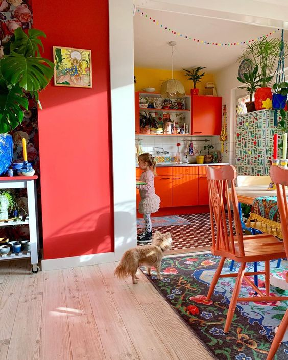 a colorful retro space in bright red, blue and yellow plus lots of bright patterns