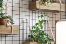 08 hanging shelves of wood and leather like these ones can become your own rustic wall garden