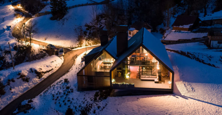 This is how the house looks in the winter, at night, when all the lights are on