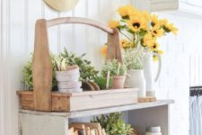 09 a farmhouse cabinet instead of a console, a tool box with platers and a floral arrangement in a vintage pitcher