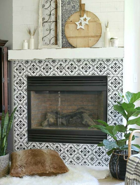 monochromatic tiles with a beautiful Moroccan inspired pattern add a boho feel to the living room