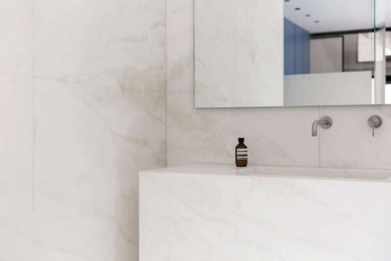 The sink is also cutout of a large piece of marble