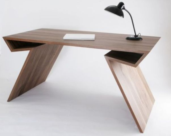 a sculptural desk feels mid-century modern yet looks rather contemporary plus features some storage niches