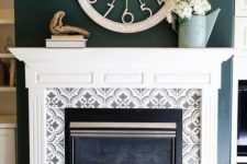 10 grey and white pattern mosaic tiles around the fireplace and on the floor plus a vintage white mantel create a chic and refined look