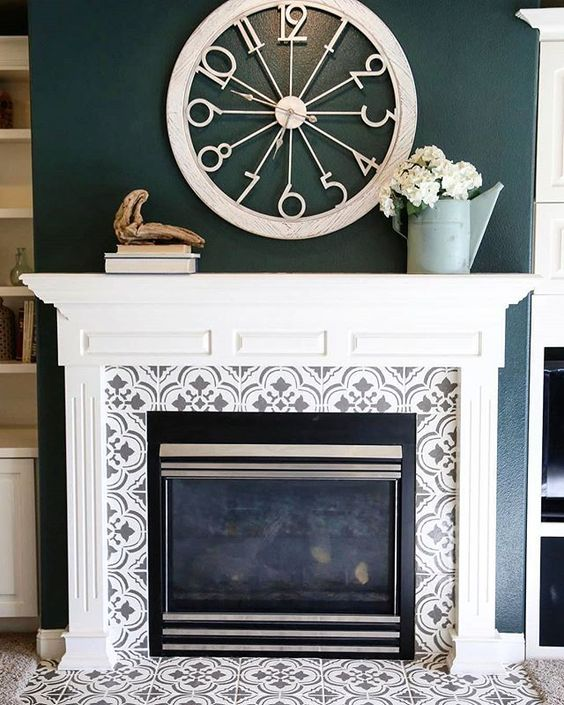 grey and white pattern mosaic tiles around the fireplace and on the floor plus a vintage white mantel create a chic and refined look