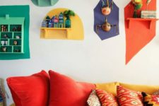 11 a colorful retro living room with a yellow and red sofa and bright touches on the wall – each shelf is different and highlighted with a different color