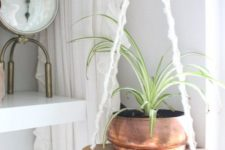 11 an easy hanging shelf of a cutting board and some macrame cords with a copper planter looks very boho-like