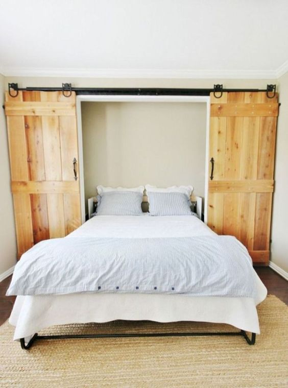 a cool Murphy bed hidden behind sliding barn doors is a great idea for a rustic space