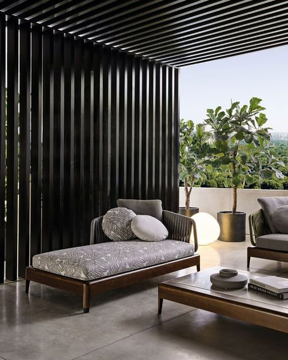 a modern dark stained outdoor daybed looks elegant and simple and will work for many outdoor spaces