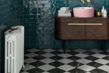 12 a retro bathroom with emerald tiles on the walls and black and white marble tiles on the floor