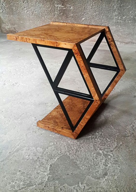 this geometric coffee table built of plywood and metal can be used as a stool, too, which is cool