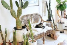 13 a bright boho summer entryway done with lots of cacti, a rattan bench with pillows and macrame