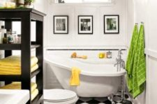 13 a monochromatic bathroom done with black and white tiles on the floor and spruced up with colorful towels and textiles