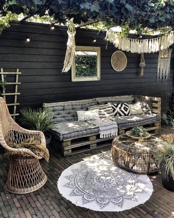 a pallet daybed can be DIYed, and you may add printed pillows and blankets - it's a fit for many spaces including this boho one