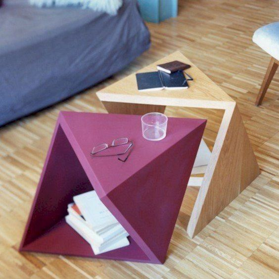 catchy geometric coffee table duo in pink and light stain is a creative idea, bold design and you can stack them to store