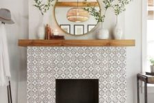 13 elegant monochromatic pattern tiles and a black touch on the floor make up a chic rustic look