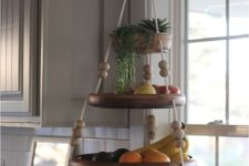 14 a fun hanging shelf for fruit with beads and ropes and some succulents on top is a cute and easy idea