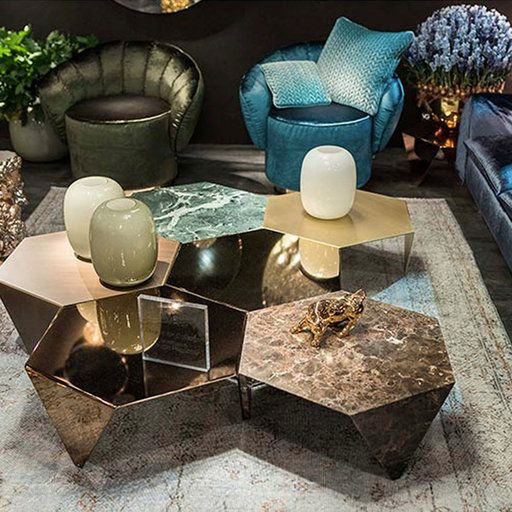 an arrangement of hexagon coffee tables done with various finishes and in various colors can be used together or separately
