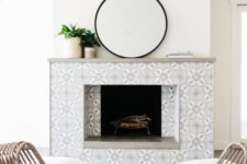 14 keep the space neutral with grey and white patterned mosaic tiles that add chic and elegance to the piece