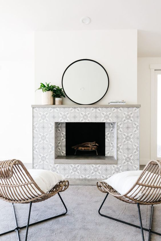 keep the space neutral with grey and white patterned mosaic tiles that add chic and elegance to the piece