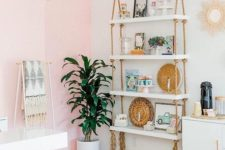 15 a hanging shelving unit with white shelves and simple ropes with long fringe add a boho feel to the glam space