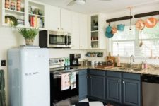 15 a retro kitchen with a black and white tile floor, colorful pots and pans and a retro-inspired pastel fridge