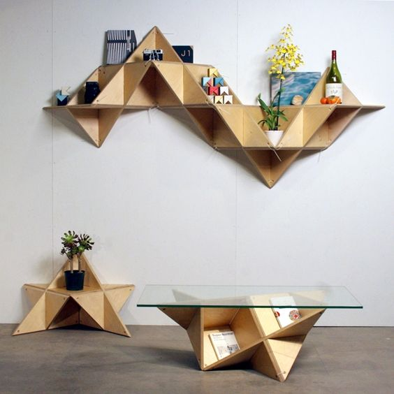geometric plywood furniture - a shelf, a floor storage unit, a coffee table with a glass table top