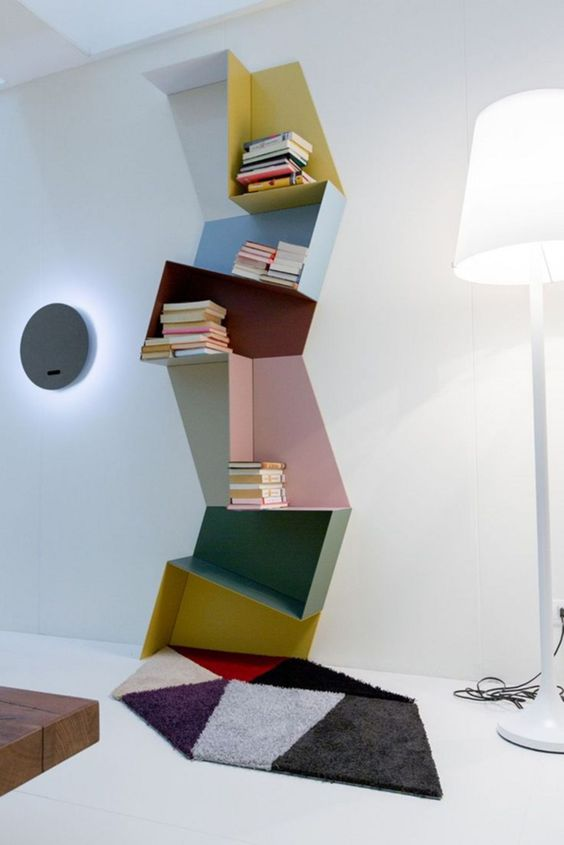 a creative colorful geometric shelving unit done of several parts and in various colors