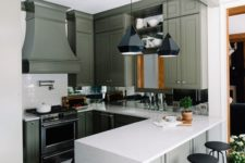 17 a retro kitchen renovation with green cabinets and a black and white tile floor for a more retro feel