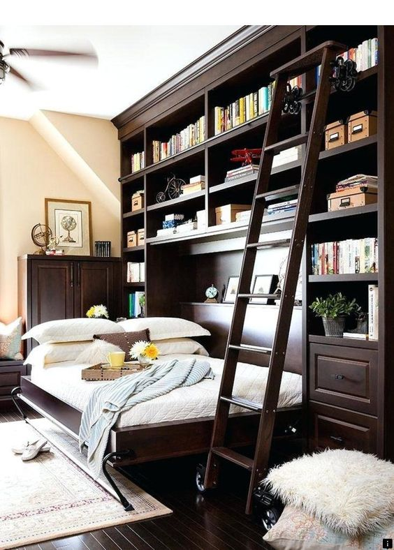 a traditional home office with a dark stained bookcase and a horizontally built-in Murphy bed right in it
