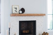 17 marble chevron clad tiles and a wooden mantel create a chic and stylish look and make the fireplace more elegant