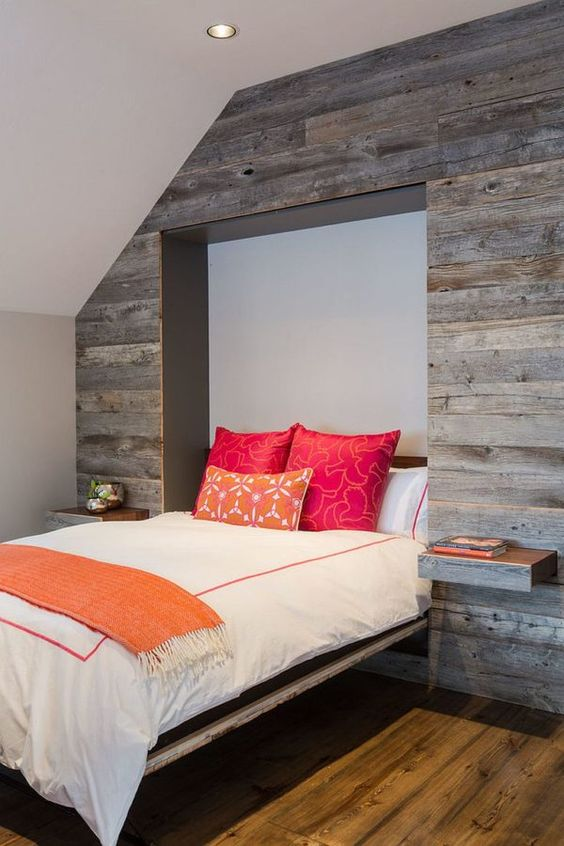 a Murphy bed and pull-out nightstands disappear into the reclaimed wood wall when not needed