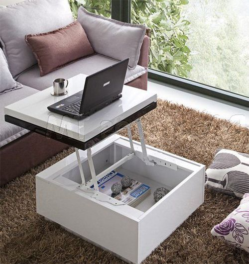 a multifunctional coffee table with a rising top that can be used as a desk