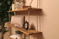 18 a rustic hanging shelf with ropes and simple wooden shelves can be DIYed for any space of your home