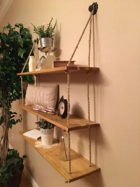 a rustic hanging shelf with ropes and simple wooden shelves can be DIYed for any space of your home