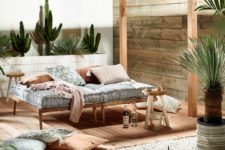 18 a simple and welcoming wooden daybed with a comfy mattress and pillow placed in a cabana to avoid sunlight