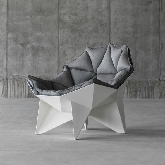 a geometric chair with a geometric upholstered cover is a chic statement for a contemporary or minimalist space